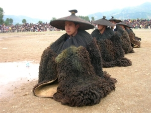 Men in traditional Yi coats